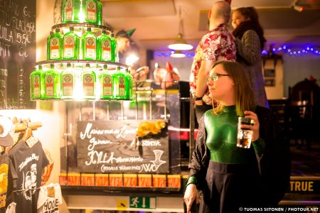 A Chandelier Made Out Of Jägermeister And A Green Catsuit In A Pub