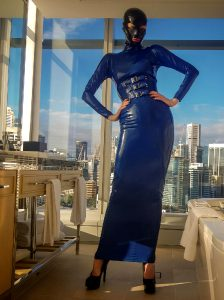 Getting Ready To Go Out For The Night. Latex Hobble Dress With Built In Corset