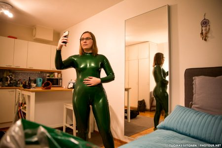 Selfie In A Metallic Green Neck-entry Catsuit