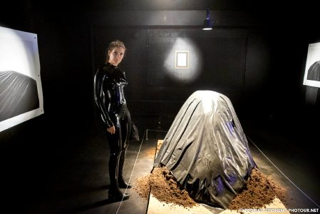 Wearing A Latex Catsuit To An Art Exhibition, We Found A Mound Of Dirt Covered In Latex As Well