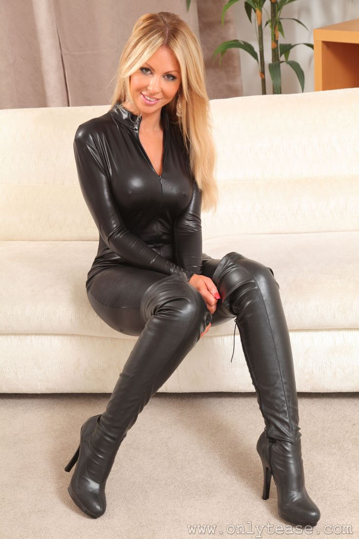 Sexy Blonde In Catsuit And Boots